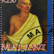 Stockfoto: MALAWI - CIRC2004: stamp printed in Malawi shows Mohandas Karamchand Gandhi, circ2004