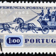 Foto Stock: PORTUGAL - CIRC1963: stamp printed in Portugal shows Postal chariot, circ1963