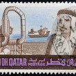 QATAR - CIRCA 1980: A stamp printed in Qatar shows a portrait of Sheikh Khalifa bin Hamed Al-Thani and industry, circa 1980 - Zdjęcie stockowe