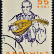 ROMANI- CIRC1961: stamp printed in Romanishows portrait of traditional musiciplaying on cobza, folk instrument of lute family, Circ1961 — Stock Photo #21238117