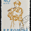 ROMANIA - CIRCA 1961: stamp printed in Romania shows Peasants playing musical instruments, Flute, circa 1961 - Zdjęcie stockowe