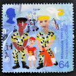 Stock Photo: UNITED KINGDOM - CIRC1999: stamp printed in Great Britain shows Soldiers with Boy (Peace-keeping), circ1999