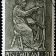 Stock Photo: VATICAN - CIRC1966: stamp printed in Vaticshows Bas reliefs of arts and crafts, painter, circ1966