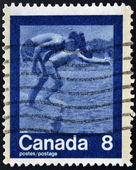 CANADA - CIRCA 1974: A stamp printed in Canada shows Children Diving, circa 1974 — ストック写真