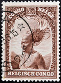 BELGIAN CONGO - CIRCA 1942: A stamp printed in Belgian Congo shows Head of a native men, circa 1942 — ストック写真