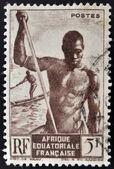 FRENCH EQUATORIAL AFRICA - CIRCA 1947: A stamp printed in former French Equatorial region of Africa shows men canoe, circa 1947 — Stock Photo