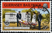 GUERNSEY BAILIWICK - CIRCA 1977: A stamp printed in Guernsey dedicated to St. John Ambulance Centenary, shows voluntary service, circa 1977 — Stock Photo