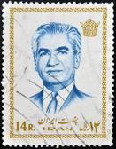 IRAN - CIRCA 1972: A stamp featuring Mohammad Reza Pahlavi, the last Shah before the 1979 Iranian revolution, circa 1972 — Zdjęcie stockowe
