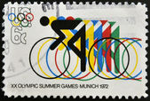 UNITED STATES OF AMERICA - CIRCA 1972: a stamp printed in USA shows Bicycling and Olympic Rings, 20th Summer Olympic Games, Munich, circa 1972 — Stock Photo