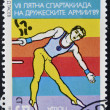 Stock fotografie: BULGARI- CIRC1989: stamp printed in Bulgarishows athlete doing gymnastics, circ1989
