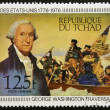Постер, плакат: CHAD CIRCA 1976: A stamp printed in Chad shows shows Washington crossing the Delaware by Emanuel Leutze circa 1976