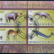 Постер, плакат: DJIBOUTI CIRCA 2009: stamps printed in Djibouti showing prehistoric animals circa 2009