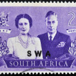 Stock Photo: SOUTH AFRIC- CIRC1947: stamp Printed in South Africshows King George VI and wife, commemorate British Royal family visit to RSA, circ1947