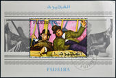 FUJEIRA - CIRCA 1972: A stamp printed in Fujeira shows the famous movie comedy duo of Stan Laurel and Oliver Hardy, circa 1972 — Stock Photo