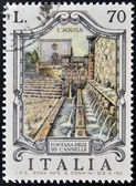 ITALY - CIRCA 1975: stamp printed in Italy shows Fountain of the 99 faucets in Aquila, circa 1975 — Stock Photo