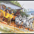 CAMBODIA - CIRCA 1989: A stamp printed in the Republic of Kampuchea (Cambodia) shows horse and coach, circa 1989 - Stock Photo