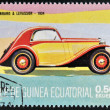 Stock Photo: EQUATORIAL GUINE- CIRC1974: stamp printed in Guinededicated to vintage cars, shows Panhad and Levassor, 1934, circ1974