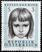 AUSTRIA - CIRCA 1966: a stamp printed in Austria shows Young, 10th anniversary of saving infant society, circa 1966 — Stock Photo