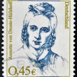 Royalty-Free Stock Photo: GERMANY - CIRCA 2003: A stamp printed in Germany shows portrait of Annette von Droste-Hulshoff, the 19th century German author and poet, circa 2003