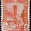 TUNISIA - CIRCA 1923: stamp printed in Tunisia shows Mosque and street, Tunis, circa 1923 — Stock Photo