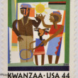Foto de Stock  : UNITED STATES - CIRC2009: stamp printed in USshows Kwanzacelebration, circ2009