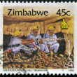 ZIMBABWE - CIRCA 1995: A stamp printed in Zimbabwe shows Underground drilling, teamwork, circa 1995 — Stock Photo #23141428