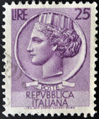 ITALY - CIRCA 1977: stamp printed in Italy shows head of a woman, who symbolize Italy after Syracusean Coin, circa 1977 — Stock Photo