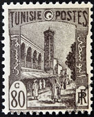 TUNISIA - CIRCA 1923: stamp printed in Tunisia shows Mosque and street, Tunis, circa 1923 — Stock Photo