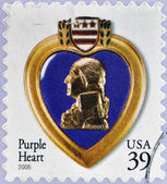 UNITED STATES OF AMERICA - CIRCA 2006: A stamp dedicated to The Purple Heart is a United States military decoration awarded in the name of the President to those who have been wounded or killed — Foto Stock