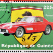 GUINEA - CIRCA 1998: Stamp printed in Guinea dedicated to anniversary of Enzo Ferrari, shows Ferrari 410 Superamerica, circa 1998 - Stock Photo