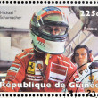 GUINEA - CIRCA 1998: Stamp printed in Guinea dedicated to anniversary of Enzo Ferrari, shows Michael Schumacher, circa 1988 - Stock Photo