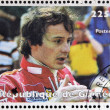 Royalty-Free Stock Photo: GUINEA - CIRCA 1998: Stamp printed in Guinea dedicated to anniversary of Enzo Ferrari, shows Gilles Villeneuve, circa 1998