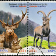 SPAIN - CIRCA 2012: Stamps printed in Spain shows ibex and red deer of the Carpathian, circa 2012 - Stock Photo