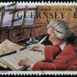 GUERNSEY - CIRCA 1990: A stamp printed in Guernsey shows Admiral James Saumarez and his log books, circa 1990 — Stock Photo