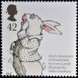 UNITED KINGDOM - CIRC2006: stamp printed in Great Britain dedicated to animal tales, shows White Rabbit from Lewis Caroll's 'Alice's Adventures in Wonderland', circ2006 — Stock Photo #23303670