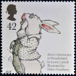 UNITED KINGDOM - CIRCA 2006: A stamp printed in Great Britain dedicated to animal tales, shows White Rabbit from Lewis Caroll's 'Alice's Adventures in Wonderland', circa 2006 — Stock Photo #23303670