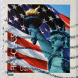 UNITED STATES OF AMERICA - CIRCA 2006: A stamp printed in USA shows the The Statue of Liberty and the american flag, circa 2006. — Stock Photo