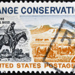 图库照片: UNITED STATES OF AMERIC- CIRC1961: stamp printed in USshows Trail Boss and Modern Range, circ1961