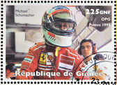 GUINEA - CIRCA 1998: Stamp printed in Guinea dedicated to anniversary of Enzo Ferrari, shows Michael Schumacher, circa 1988 — Stock Photo