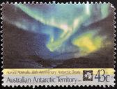 AUSTRALIAN ANTARCTIC TERRITORY - CIRCA 1991: Stamp printed in australia shows Aurora Australis, circa 1991 — Stock Photo