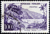 FRANCE - CIRCA 1957: stamp printed in France shows Guadeloupe, Sens river, circa 1957 — Stock Photo