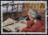 GUERNSEY - CIRCA 1990: A stamp printed in Guernsey shows Admiral James Saumarez and his log books, circa 1990 — Stock Photo