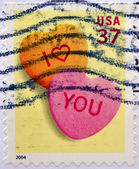 UNITED STATES OF AMERICA - CIRCA 2004: An I love you stamp printed in the USA shows two hearts, circa 2004 — Stock Photo