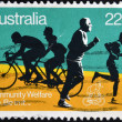 Foto de Stock  : AUSTRALI- CIRC1980: stamp printed in Australishows Joggers and Bicyclists, with inscription Community Welfare, Life. Be in it, circ1980