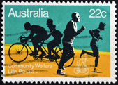 AUSTRALIA - CIRCA 1980: A stamp printed in Australia shows the Joggers and Bicyclists, with the inscription Community Welfare, Life. Be in it, circa 1980 — Stock Photo