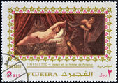 FUJEIRA - CIRCA 1985: Stamp printed in Fujeira shows Joseph and Potiphar's wife by Tintoretto, circa 1985 — Stock Photo