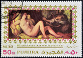 FUJEIRA - CIRCA 1985: Stamp printed in Fujeira shows Danae by Tintoretto, circa 1985 — Stock Photo