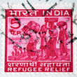 "INDIA - CIRCA 1971: A stamp printed in India shows refugees from East Pakistan with inscription ""Refugee relief"", circa 1971. — Stock Photo"