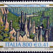 ITALY - CIRCA 1999: A stamp printed in Italy shows Earth Pyramids in Segonzano, circa 1999 — Stock Photo
