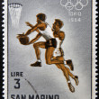 Stock Photo: SAN MARINO - CIRC1964: stamp printed in SMarino shows Basketball, 18th Olympic Games, Tokyo, circ1964
